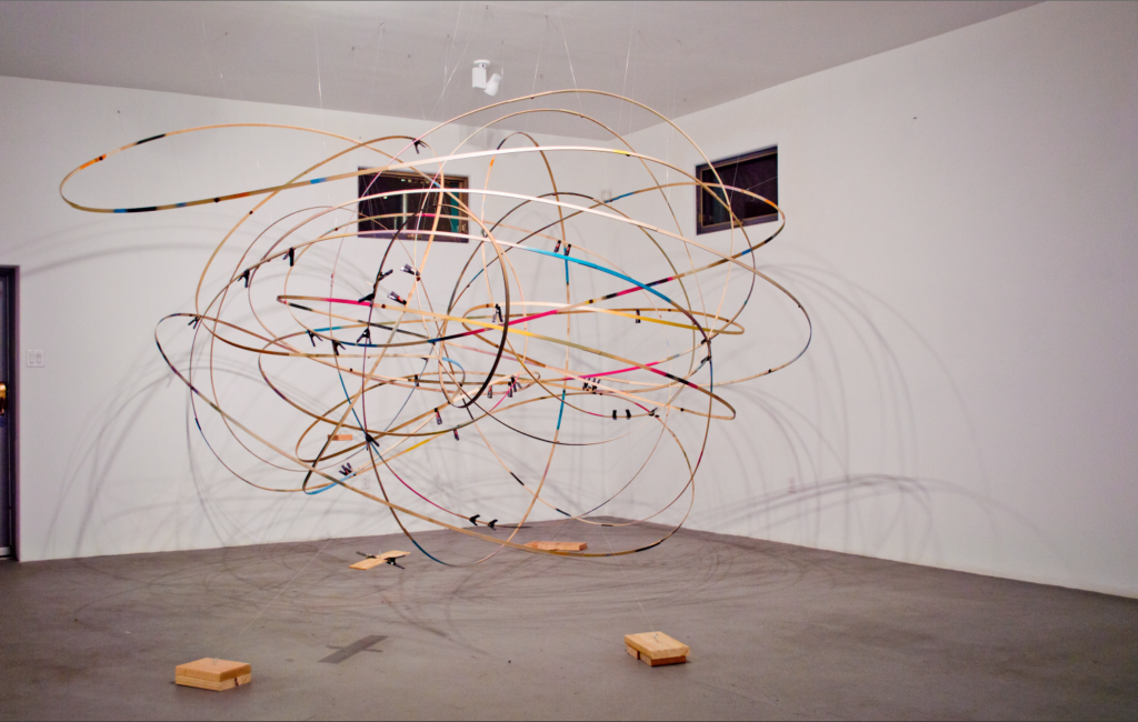 Karl Hofmann, 2016, Comes Around, Goes Around (again), dimensions variable 12' x 12' x 12', poplar, fishing line, spray paint