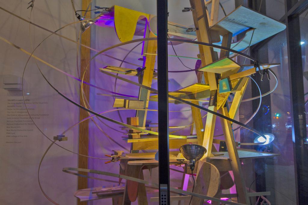 Karl Hofmann, 2017, In The Balance, scrap wood, spraypaint, concrete, shop lamps, dimensions variable, 516 Arts