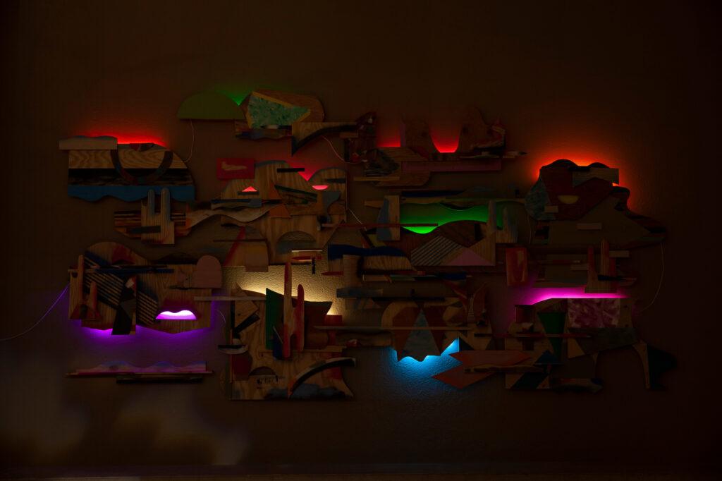Karl Hofmann, Shapeshifters, 2019 paint on re-used wood, LEDs, 20' x 9'